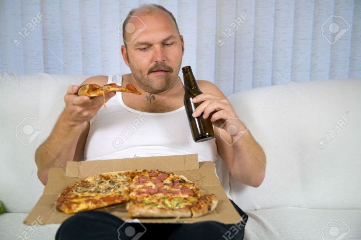 1849050-unhealthy-fat-man-sitting-on-couch-drinking-beer-and-eating-pizza
